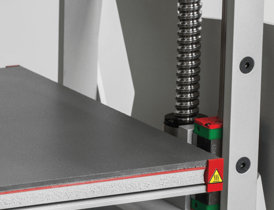 Professional 3D printer 3DGence ONE. Close-up of leveling screws and ceramicheatbed.