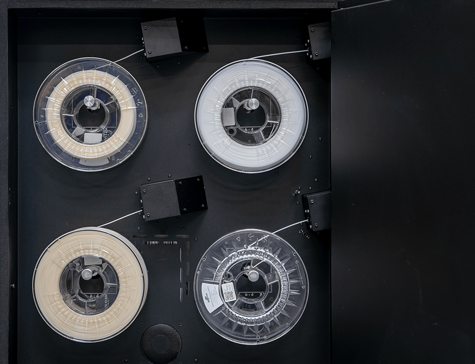 Industrial 3D printer INDUSTRY F340. Close-up of filament chamber with four filaments spools inside.
