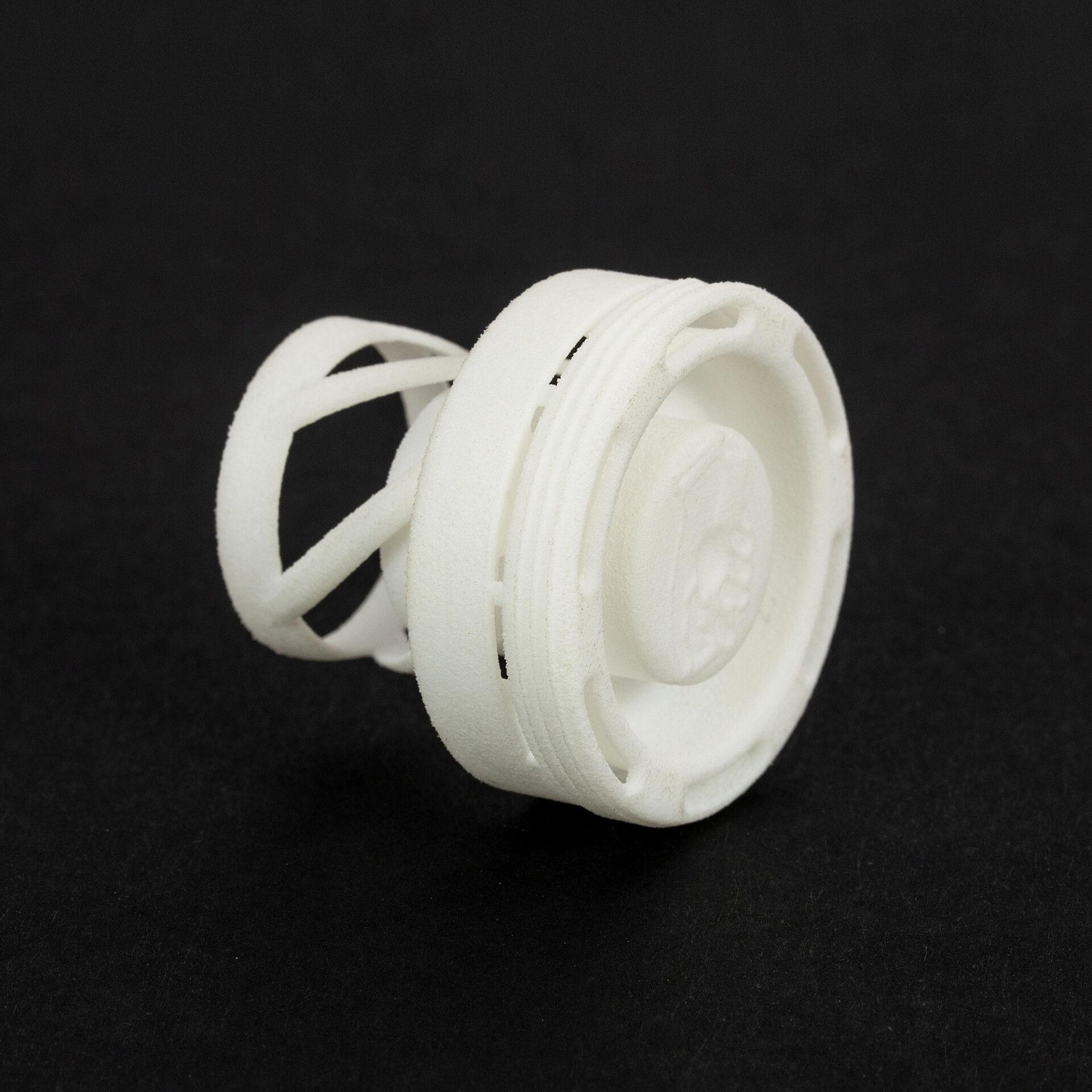 Zatyczka dociskowa wydrukowana w 3D w technologii SLS filamentem PA 2200 na drukarce 3D EOS P396